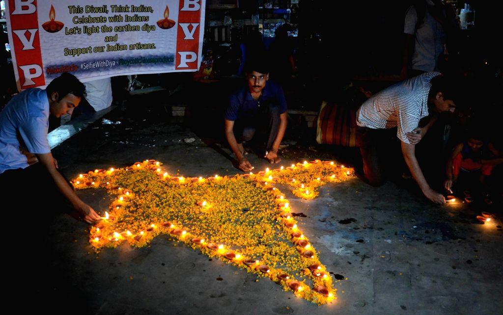 """ABVP activists celebrate on """"Dhanteras"""" in Kolkata, on Oct 28, 2016."""