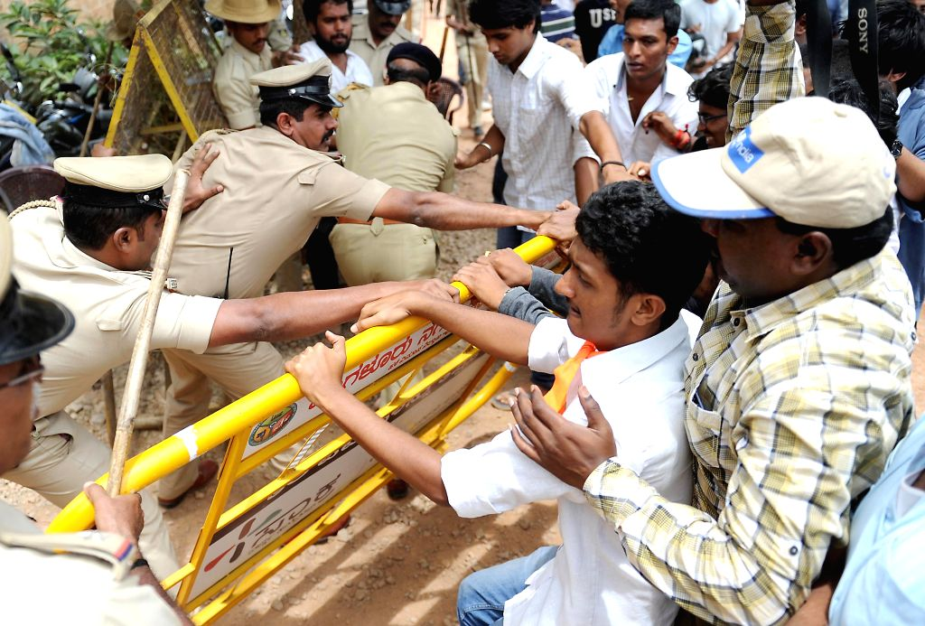 ABVP activists clash with Police personnel during a demonstration against alleged rape of a 6-year-old student in Bangalore on July 21, 2014.