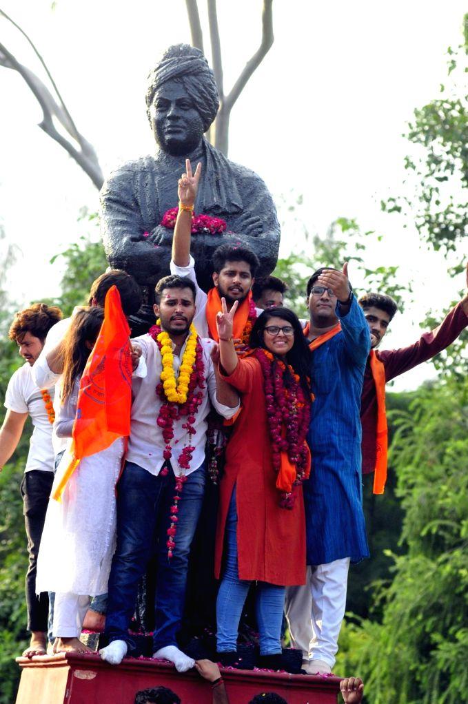 ABVP (RSS-affiliated students organisation) candidates Akshit Dhaiya, Pradeep Tanwar and Shivangi Khaewal celebrate after winning the posts of Delhi University Students Union (DUSU) ...