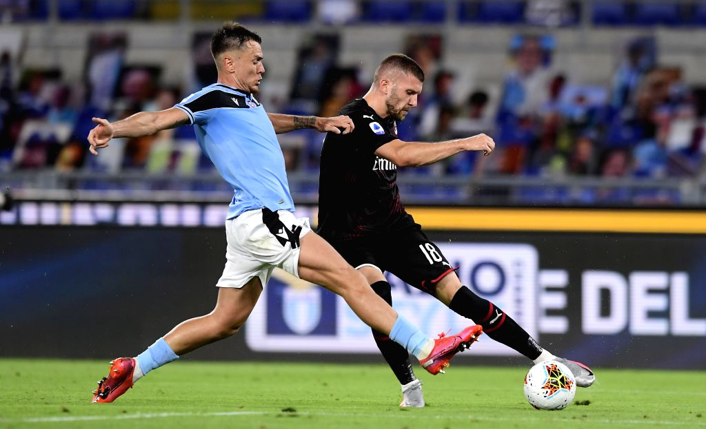 AC Milan's Ante Rebic (R) vies with Lazio's Gil Partic during a Serie A football match between Lazio and AC Milan in Rome, Italy, July 4, 2020.