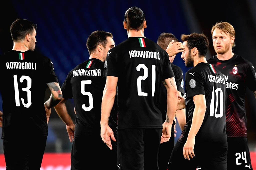 AC Milan's Hakan Calhanoglu (2nd R) celebrates his goal with teammates during a Serie A football match between Lazio and AC Milan in Rome, Italy, July 4, 2020.