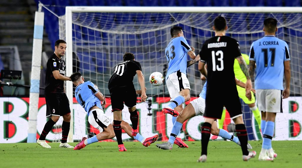 AC Milan's Hakan Calhanoglu (3rd L) scores his goal during a Serie A football match between Lazio and AC Milan in Rome, Italy, July 4, 2020.