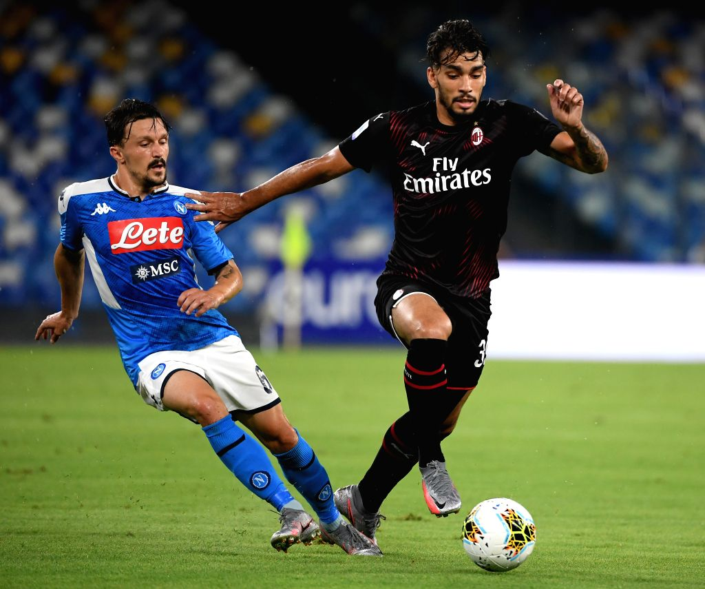 AC Milan's Lucas Paqueta (R) vies with Napoli's Mario Rui during a Serie A football match between Napoli and AC Milan in Naples, Italy, July 12, 2020.