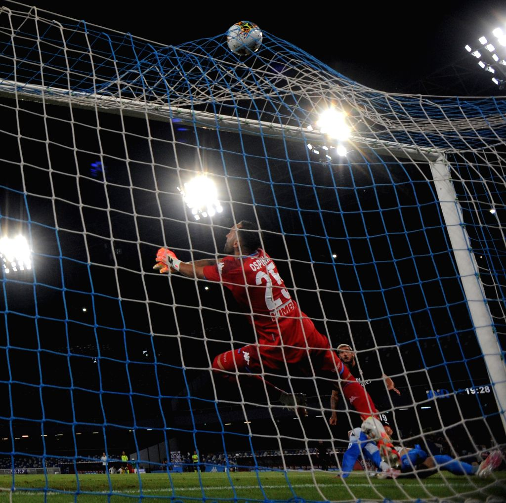 AC Milan's Theo Hernandez (R) scores during a Serie A football match between Napoli and AC Milan in Naples, Italy, July 12, 2020.
