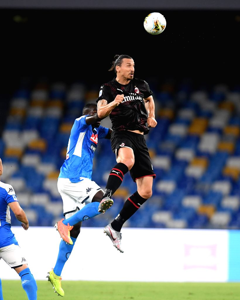 AC Milan's Zlatan Ibrahimovic (R) vies with Napoli's Kalidou Koulibaly during a Serie A football match between Napoli and AC Milan in Naples, Italy, July 12, 2020.