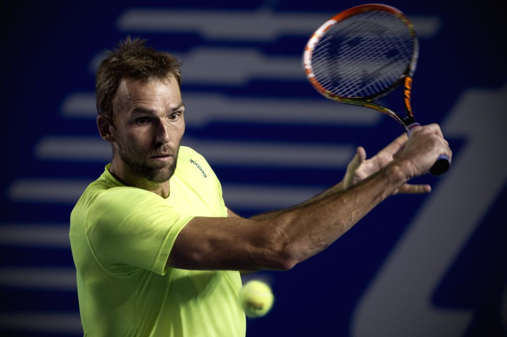 Croatia's Ivo Karlovic returns the ball during the men's singles match against Ryan Harrison of the United States at the Abierto Mexicano Telcel tennis tournament ...