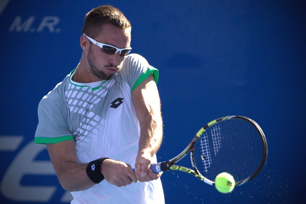 Serbia's Viktor Troicki returns the ball during the men's singles match against South Africa's Kevin Anderson at the Abierto Mexicano Telcel tennis tournament in ...