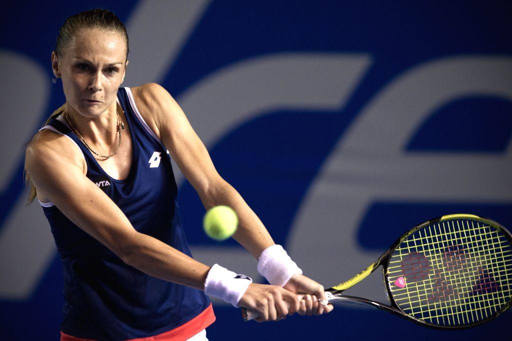 Slovakia's Magdalena Rybarikova returns the ball during the women's single match against Russia's Maria Sharapova at the Abierto Mexicano Telcel tennis tournament ...