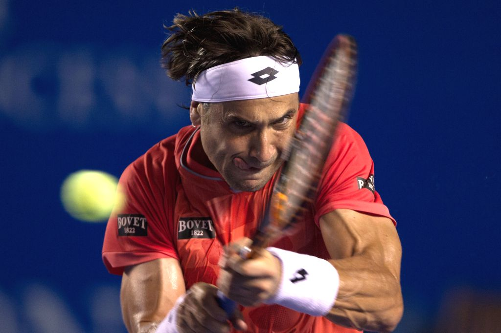 Spain's David Ferrer returns the ball during the men's singles match against Australia's Bernard Tomic at the Abierto Mexicano Telcel tennis tournament in ...