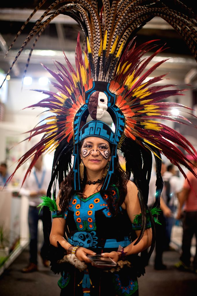 A woman wearing the traditional Aztec costume poses during Tianguis Turistico 2015, a tourism promoting event, in the city of Acapulco, State of Guerrero, Mexico, ...