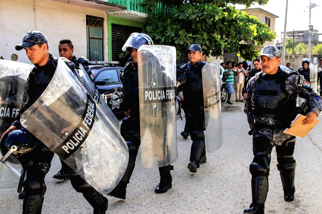 ACAPULCO (MEXICO), July 6, 2017 Police officers arrive at a prison after a clash among inmates in Acapulco, Mexico, on July 6, 2017. At least 28 people were killed in a prison riot on ...