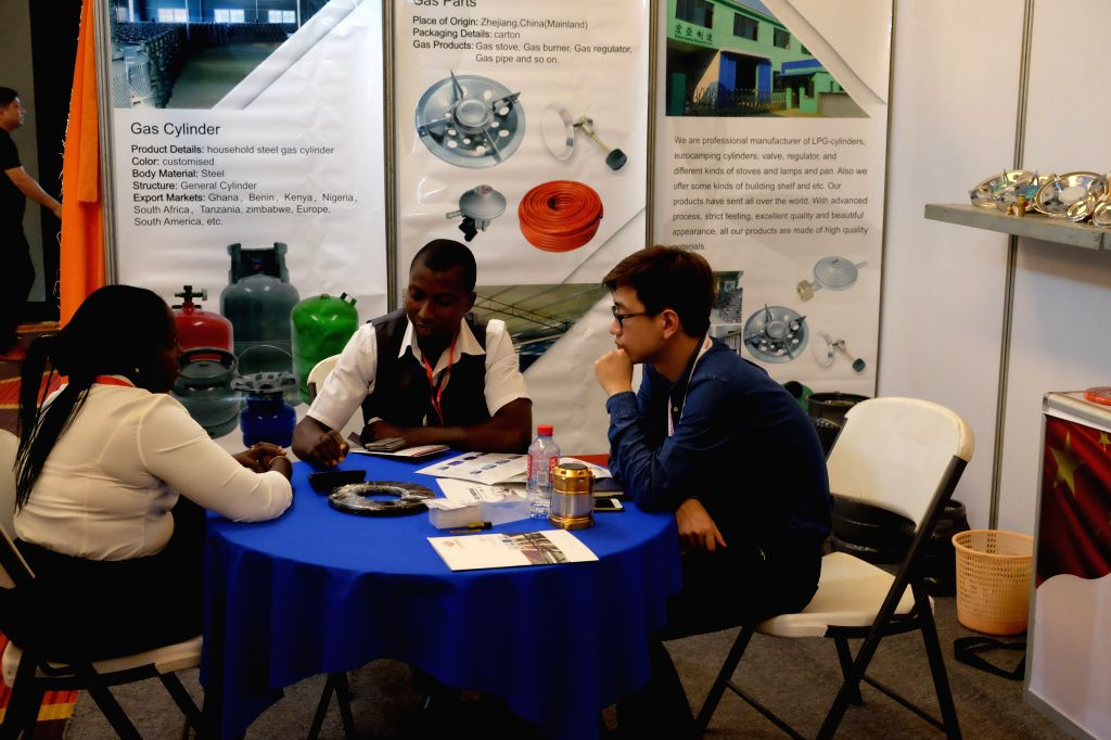 ACCRA, May 17, 2017 - Visitors communicate with an exhibitor (R) during the China Trade Week in Accra, Ghana, on May 17, 2017. Approximately 50 Chinese companies selected from various sectors, ...