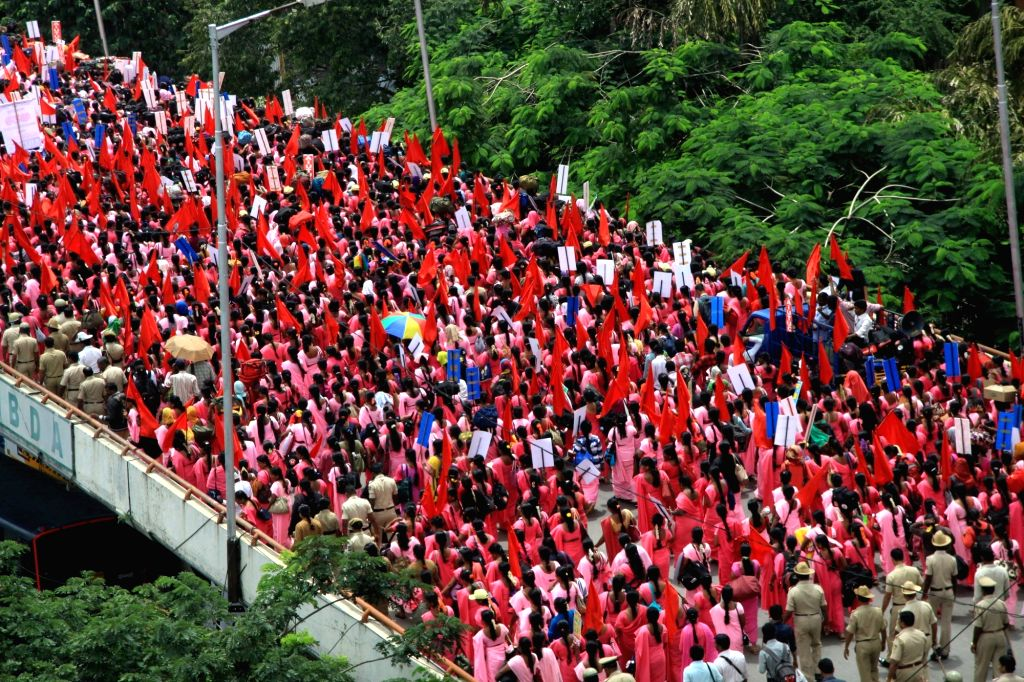 Accredited Social Health Activist (ASHA) workers stage a protest rally to press for their various demands in Bengaluru on Sept 7, 2017.