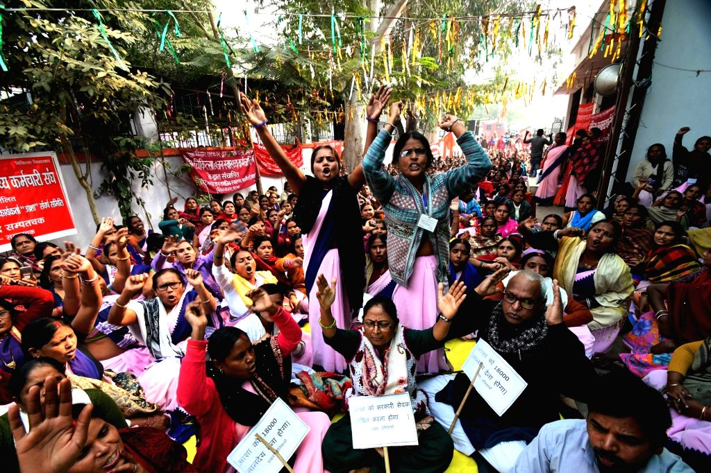 Accredited Social Health Activist (ASHA) workers stage a demonstration to press for their various demands in Patna, on Dec 10, 2018.
