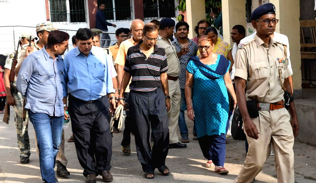 Accused in Srijan scam being taken to be produced before a CBI court in Patna, on Oct 3, 2017. The Srijan scam involves a Bhagalpur-based NGO, Srijan Mahila Vikas Sahyog Samiti Ltd, which used ...