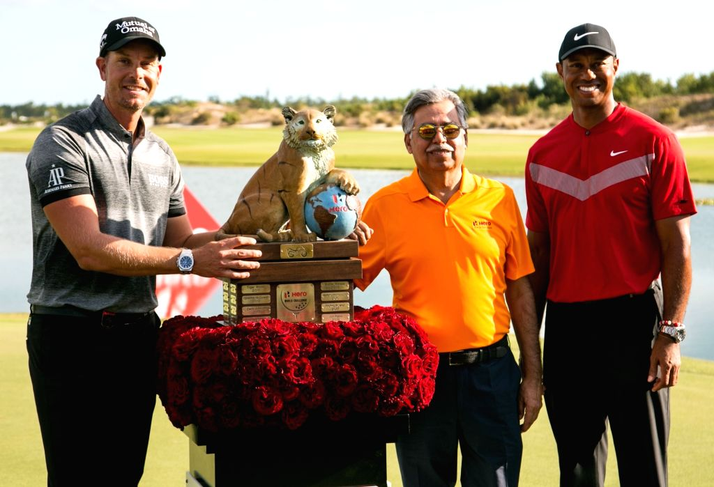 Ace golfer Tiger Woods and Hero MotoCorp Chairman Pawan Munjal with winner of 2019 Hero World Challenge, Henrik Stenson at Albany Championship Course in the Bahamas on Dec 8, 2019.