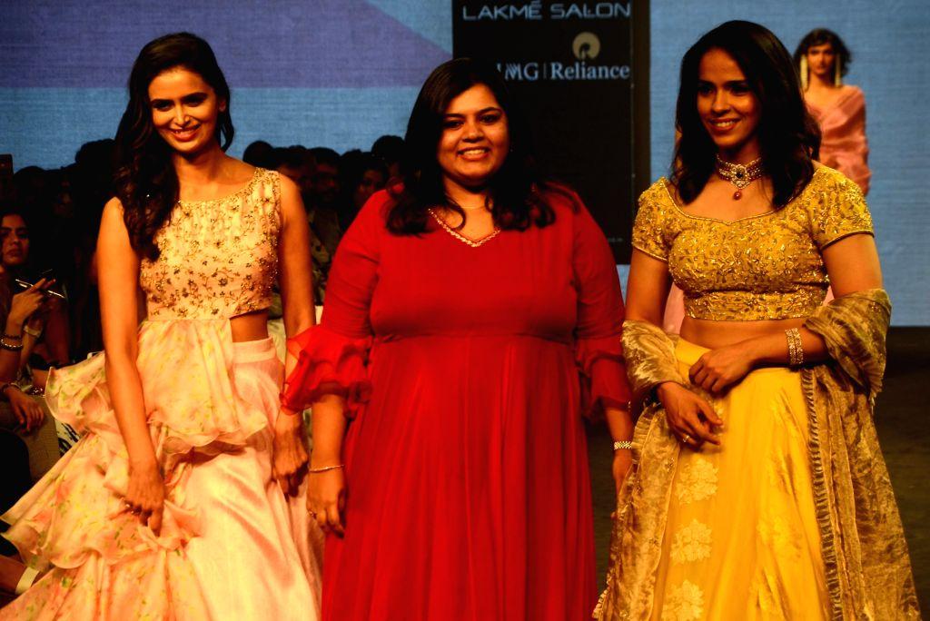 Ace shuttler Saina Nehwal along with fashion designer Vaani Raghupathy during Lakme Fashion Week (LFW) Summer/Resort 2019 in Mumbai on Feb. 2, 2019.