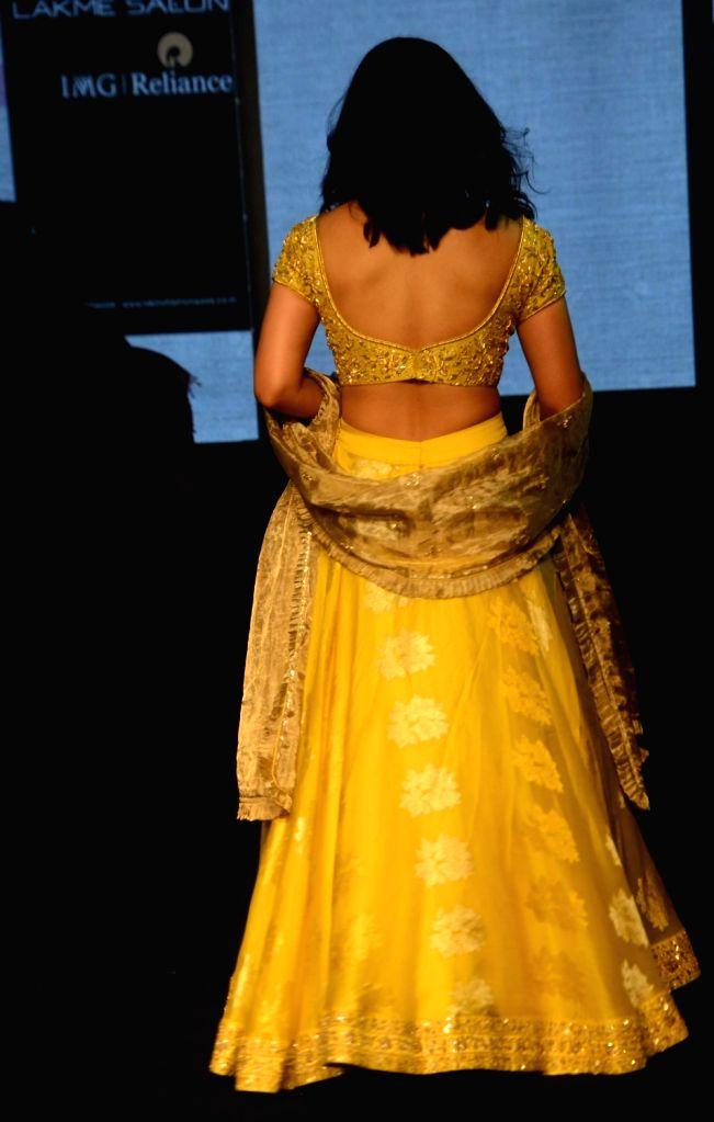 Ace shuttler Saina Nehwal showcases fashion designer Vaani Raghupathy's creation during Lakme Fashion Week (LFW) Summer/Resort 2019 in Mumbai on Feb. 2, 2019.