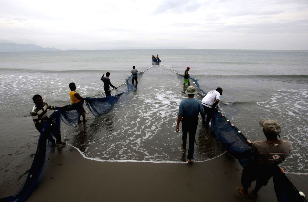 Fishermen pull their nets from the sea at Kampung Jawa in Aceh, Indonesia, Aug. 23, 2014.