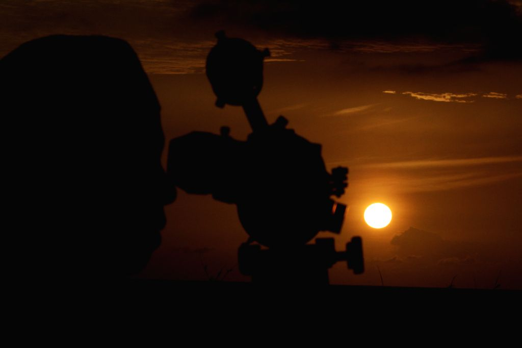 ACEH, July 5, 2016 - A Muslim man observes the position of the moon with a telescope to determine the end of the month of Ramadan as well as the first day to celebrate Eid al-Fitr festival in Aceh, ...