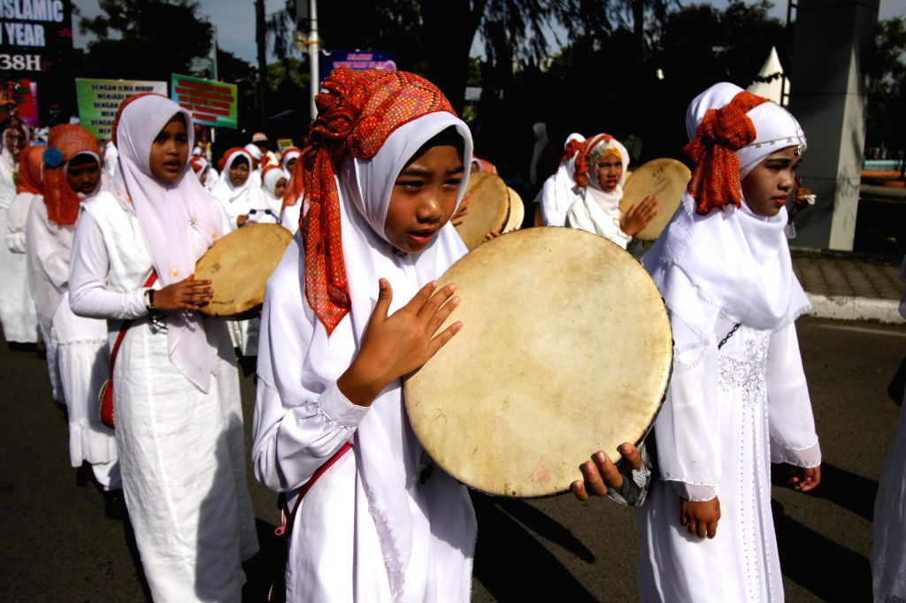ACEH, Oct. 2, 2016 - Children play tambourines during an Islamic New Year celebration in Aceh, Indonesia, Oct. 2, 2016. Various events were held to celebrate the Islamic New Year, the first day of ...