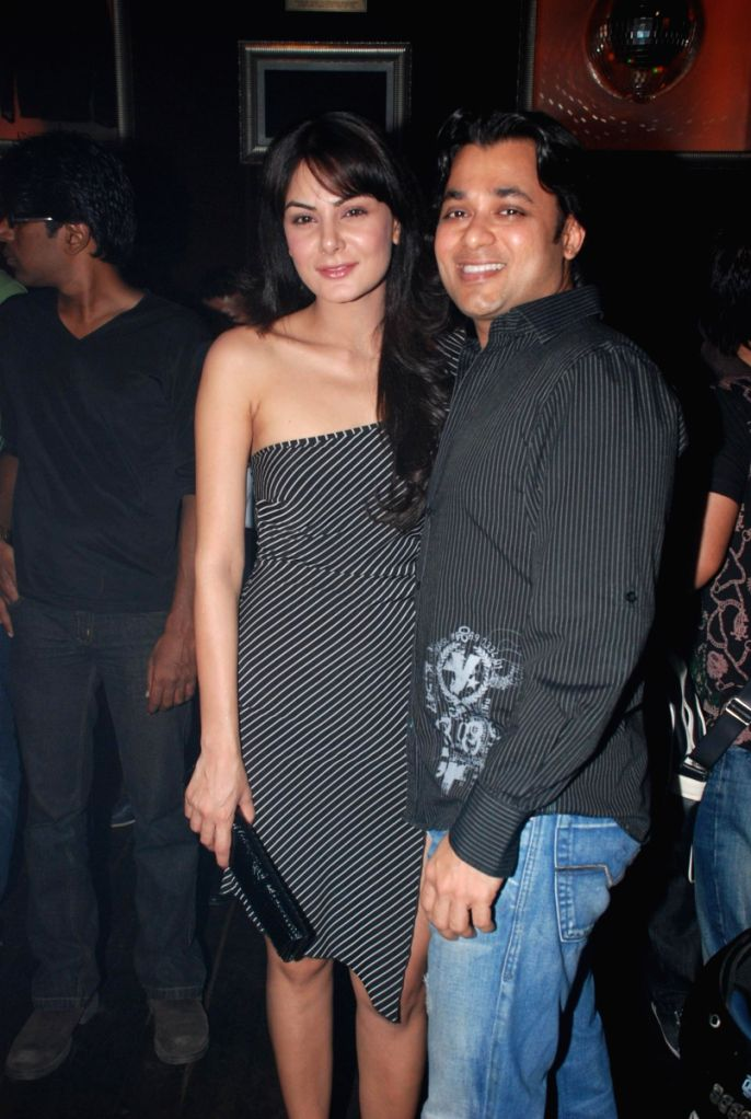 Achal Kumar with Anupam Mittal at Rolling Stone Magazine's 1st Anniversary Bash.