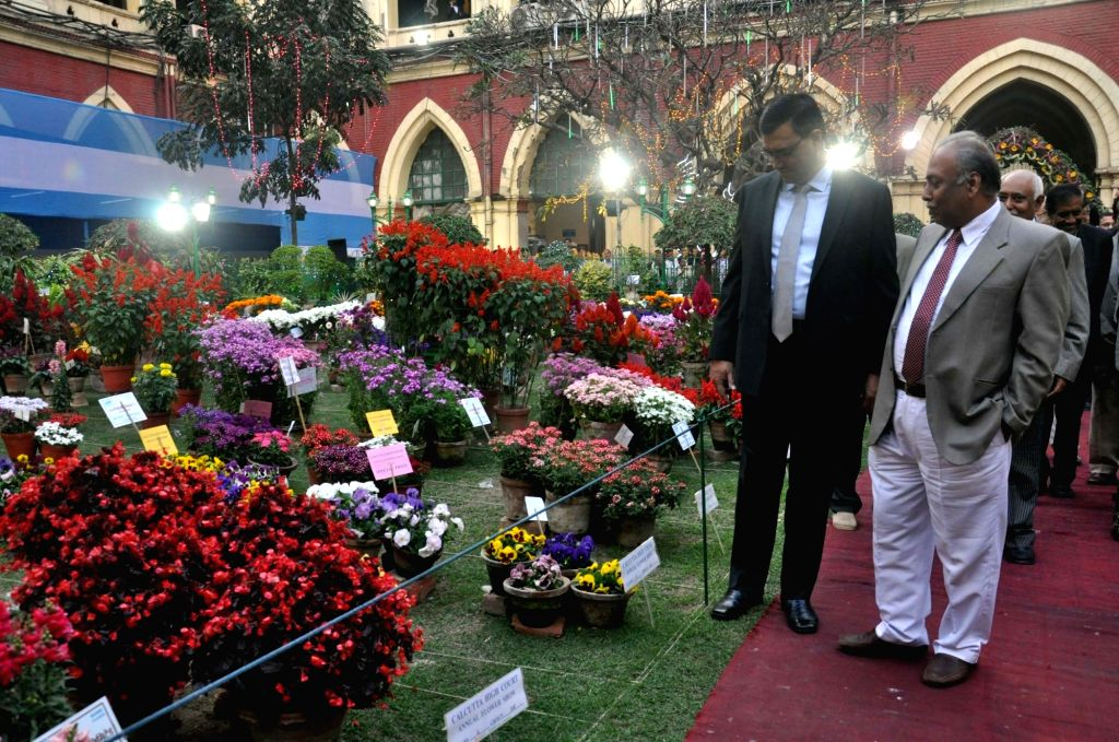 Acting Chief Justice of the Calcutta High Court Jyotirmay Bhattacharya with others during a flower show organised at Calcutta High Court in Kolkata on Feb 13, 2018.