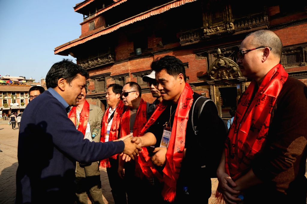 Acting Director of Nepal Tourism Board, Sunil Sharma (1st L) welcomes the visiting Chinese team during their visit to quake-damaged Patan Durbar Square in Lalitpur, ... - Sunil Sharma