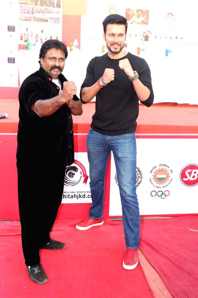 Action director Cheetah Yagnesh Shetty and actor Rajneesh Duggal during Bruce Lee's 76th birth anniversary in Mumbai on Nov 25, 2016. - Cheetah Yagnesh Shetty