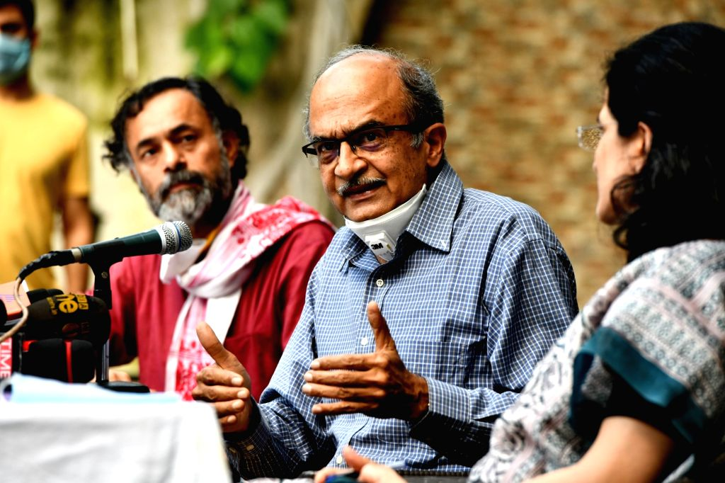 Activist-advocate Prashant Bhushan addresses a press conference after the Supreme Court on Monday imposed a token fine of Re 1 on him in the contempt case for tweets against the judiciary, ...