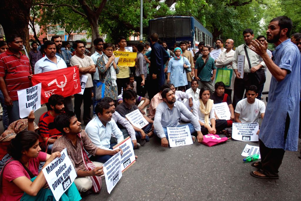 Activists and students from Delhi University and Jawaharlal Nehru University staged a demonstration outside Maharashtra Sadan in Delhi protesting against the arrest of DU professor G N Saibaba by ...