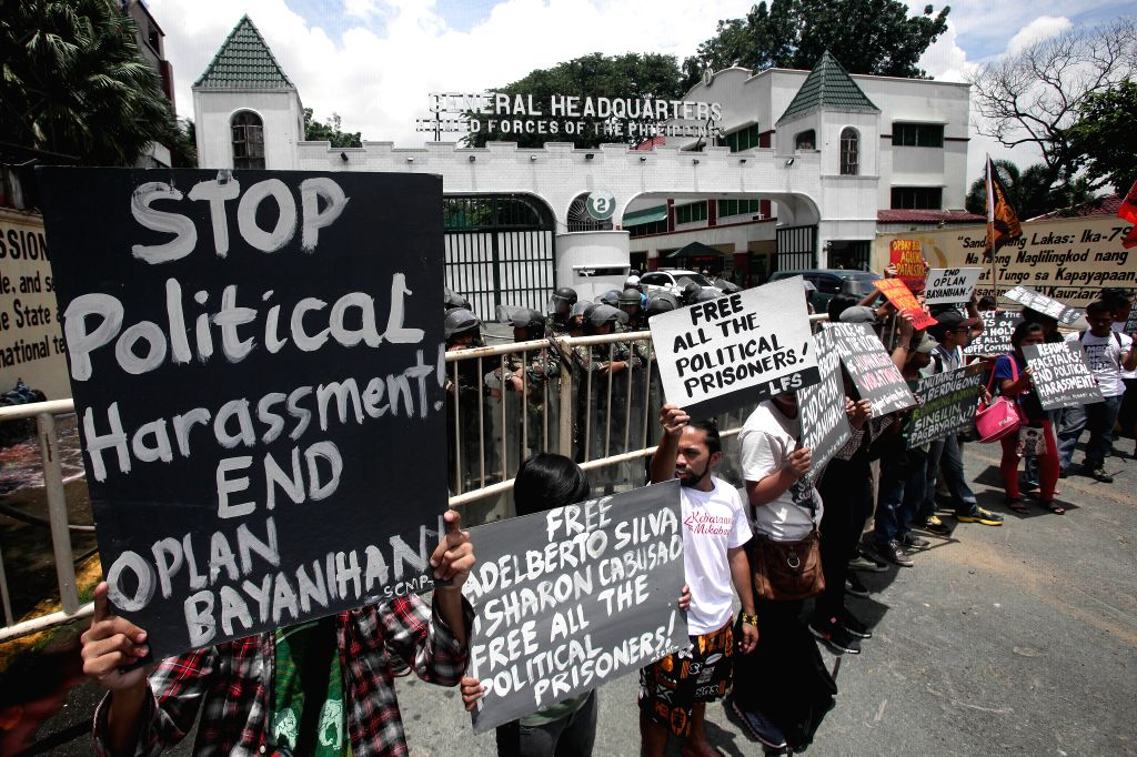 Activists holding placards attend a protest rally in front of the Armed Forces of the Philippines (AFP) headquarters in Quezon City, the Philippines, Aug. 11, ...