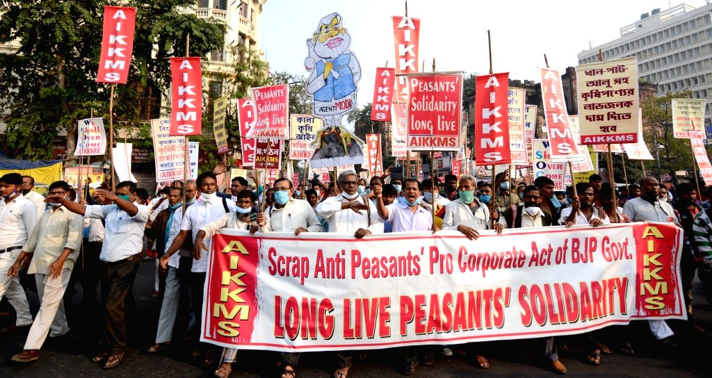 Activists of All India Krishak Khet Mazdoor Sangathan (AIKKMS) participate in a protest rally against the Central Government's new farm laws, in Kolkata on Dec 3, 2020.