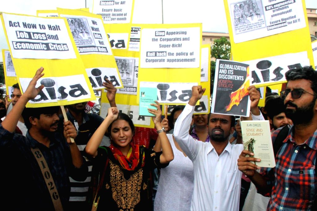Activists of All India Students Association (AISA) stage a demonstration against Finance and Corporate Affairs Minister Nirmala Sitharaman over alleged job loss and economic crisis, near ... - Nirmala Sitharaman