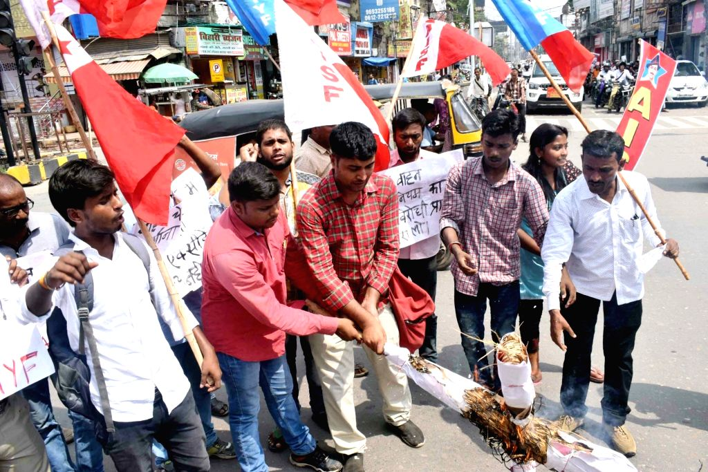 Activists of All India Students Federation (AISF) and All India Youth Federation (AIYF) stage a demonstration against Union Transport Minister Nitin Gadkari over hefty traffic penalties ... - Nitin Gadkari