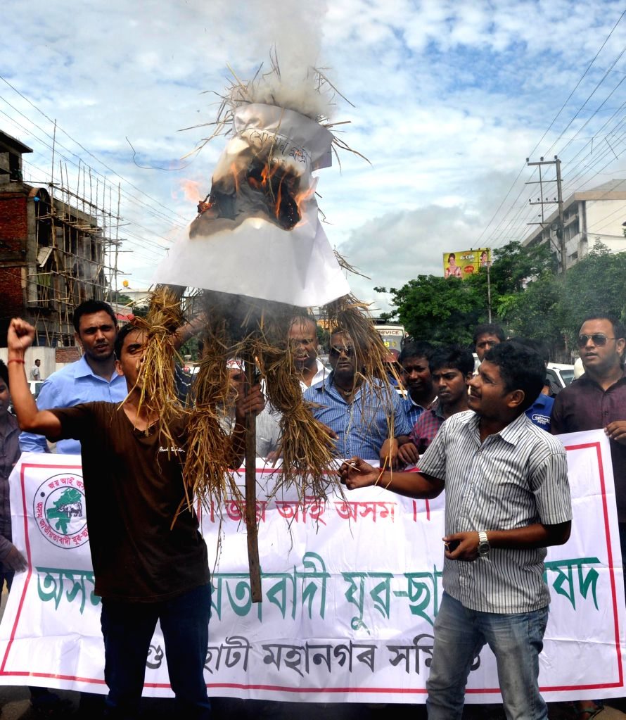 Activists of Asom Jatiyatabadi Yuba Chatra Parishad (AJYCP) burn effigies of Assam Food and Civil Supply Minister Nazrul Islam during a demonstration against hike in prices of essential commodities .. - Nazrul Islam
