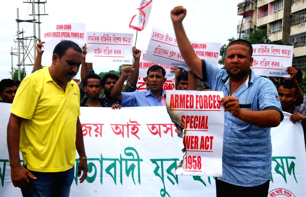 Activists of Asom Jatiyatabadi Yuva Chatra Parishad (AJYCP) burn a copy of the Armed Forces Special Power Act (AFSPA) 1958, demanding the withdrawal of the act from the North East, in Guwahati on ...