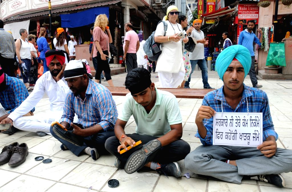 Activists of ETT-TET Pass Unemployed Teachers Union stage a demonstration to press for their various demands, in Amritsar on Aug 8, 2018.