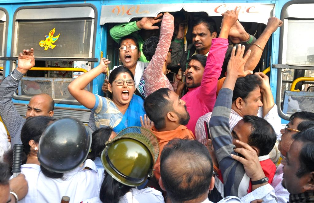 Activists of Hindu Jagaran Manch being detained as they tried to bring out a procession protesting against the firing at a Rashtriya Sawamsevak Sangh member in Kolkata, on Dec 4, 2019. ...