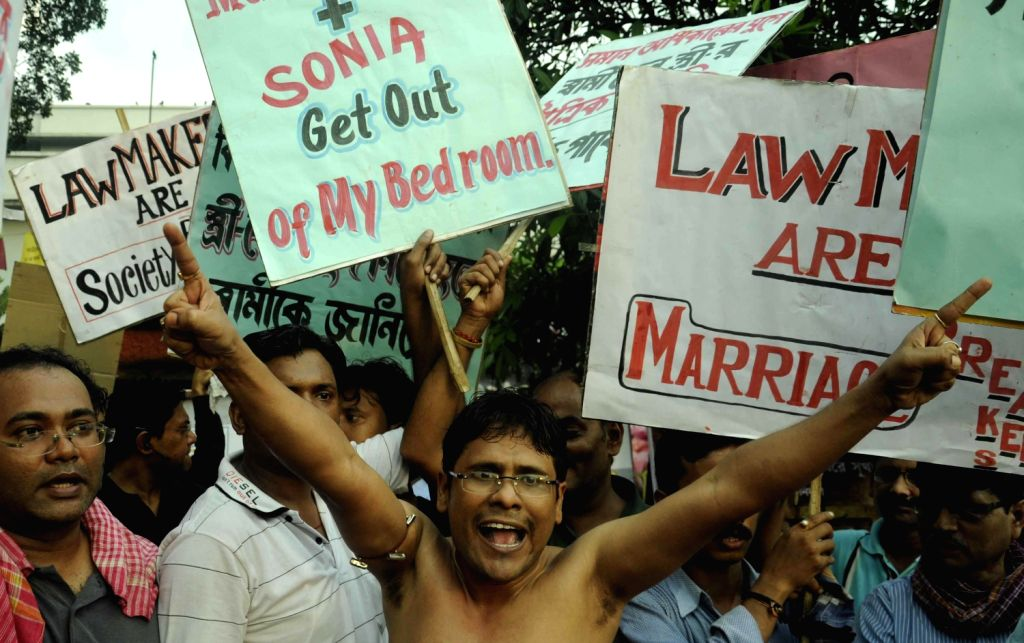 Activists of HRIDAYA organisation, during a protest rally for upcoming marriage laws in kolkata on August 25, 2013. (Photo::: IANS)