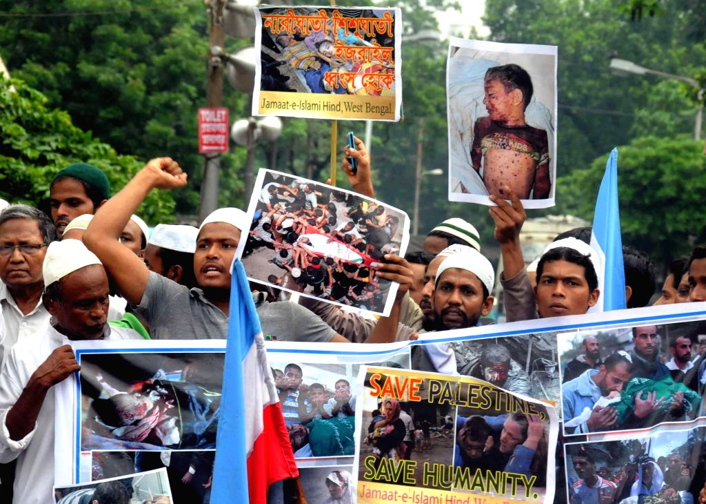 Activists of Jamaate-E-Islami Hind participate in a protest against Israeli attacks on Gaza in Kolkata on July 18, 2014.