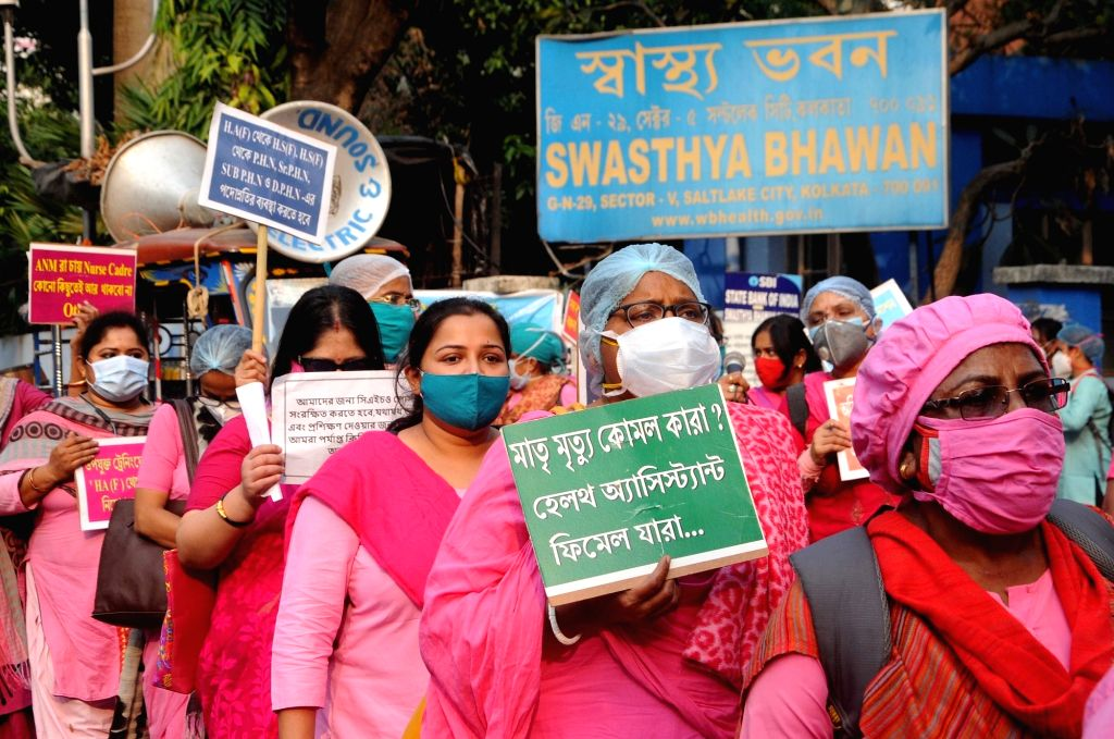 Activists of Joint Forum of All West Bengal Health Assistant and Health Supervisor Worker Association participate in a protest against the State Health Department in front of Swasthya Bhawan ...