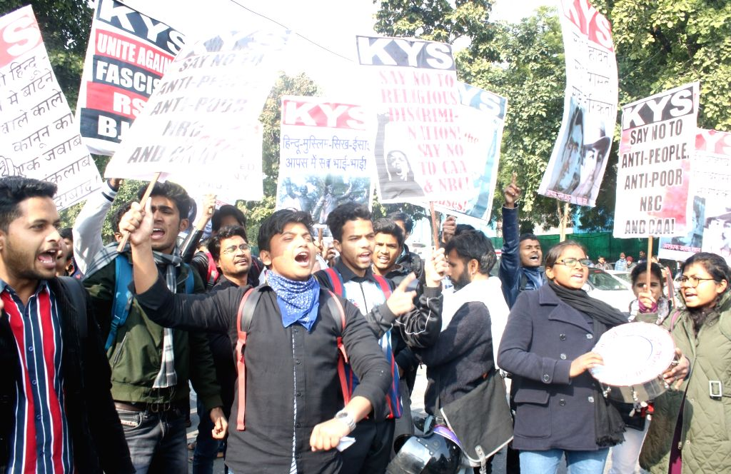 Activists of Krantikari Yuva Sangathan (KYS) participate in a protest rally taken out from Mandi House towards the HRD Ministry, against recent violence at JNU demanding the resignation of ...