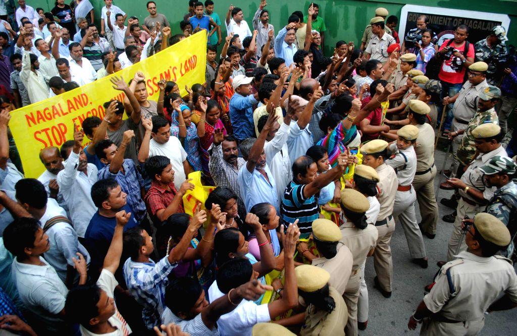Activists of Krishak Mukti Sangram Samiti (KMSS) stage a demonstration outside Nagaland House in Guwahati on Aug 18, 2014.