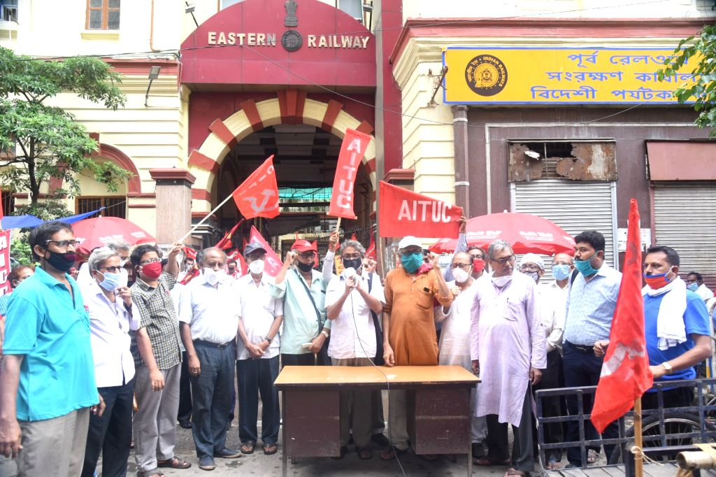 Activists of Left affiliated Central Trade Unions stage a demonstration against privatisation in the Indian Railways, in Kolkata on July 16, 2020.