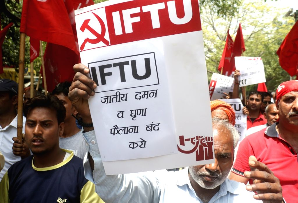 Activists of Leftist organisations participate in a protest march on International Labour Day in New Delhi, on May 1, 2019.
