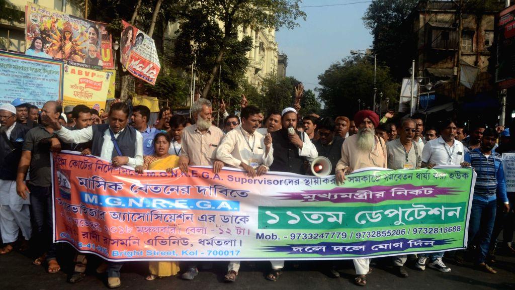 Activists of Mahatma Gandhi National Rural Employment Guarantee Act (MGNREGA) Supervisor Association stage a demonstration to press for their various demands in Kolkata, on Nov 27, 2018.