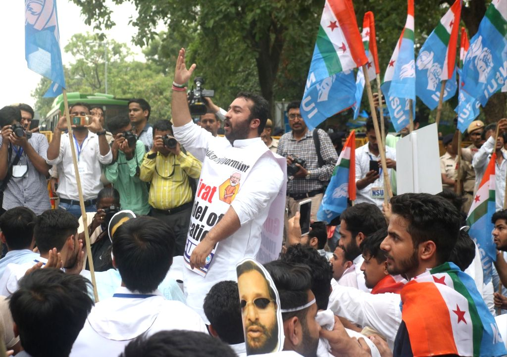 Activists of National Students' Union of India (NSUI) stage a demonstration against the Ministry of Human Resource Development (HRD) at Shashtri Bhawan, in new Delhi on July 11, 2018. ...
