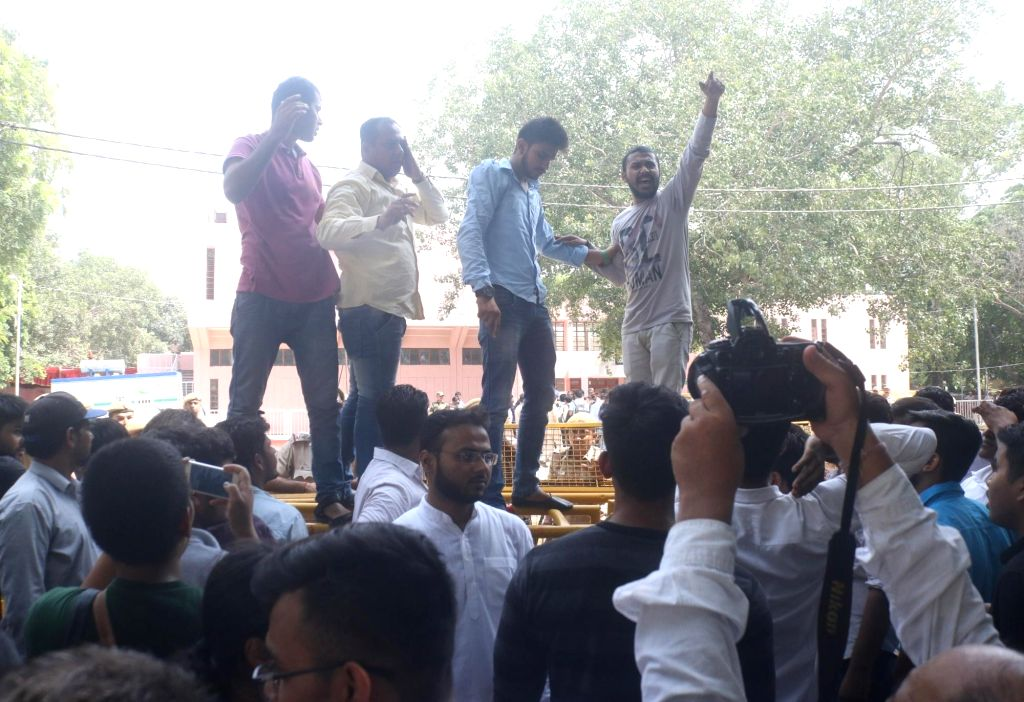 Activists of National Students' Union of India (NSUI) - the student wing of Congress, stage a demonstration after counting of votes was suspended for the day due to faulty EVMs, in New ...