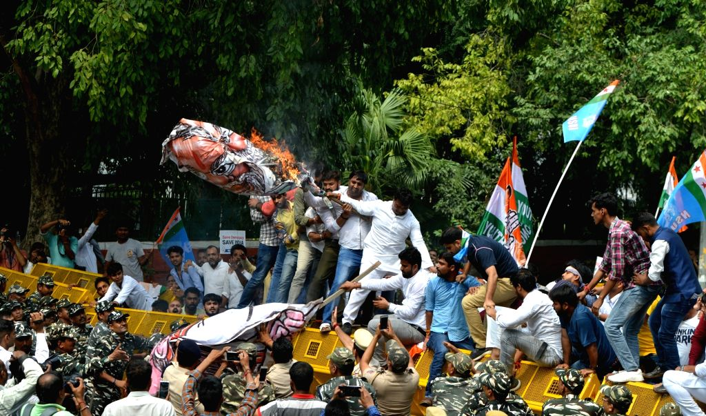Activists of National Students' Union of India (NSUI) - the students wing of the Congress - stage a demonstration against the arrest of senior party leader D.K. Shivakumar, in New Delhi on ...